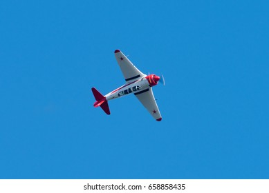 HELSINKI, FINLAND - JUNE 9, 2017: Yakovlev Yak-11 Soviet training aircraft flying upside down at the Kaivopuisto Air Show. This airplane was used by the Soviet Union and its allies during Cold War.