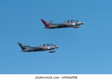 HELSINKI, FINLAND - JUNE 9, 2017: Two Silver Jets Aerobatic Team Fouga CM 170 Magister jets flying at the Kaivopuisto Air Show in Helsinki, Finland.