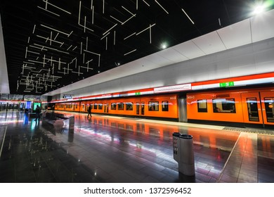 Helsinki / Finland - March 18 2019: new Keilaniemi metro station, opened in 2017 in Espoo city. Orange train with closed doors on the station