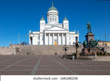 Helsinki, Finland - March 19, 2020: Helsinki Cathedral on the Senate Square is empty of people due to the outbreak of the Coronavirus.