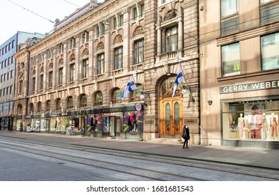 Helsinki, Finland - March 19, 2020: Very few shoppers venturing into Aleksanterin katu due to the outbreak of the Coronavirus. March 19th is a national flag day celebrating equality.
