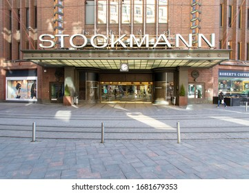 "Helsinki, Finland - March 20, 2020: ""Stocka's clock"" at Stockmann departmental store's main entrance. It is a popular meeting place, which is now empty of people due to the outbreak of the Coronavirus"