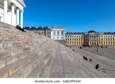 Helsinki, Finland - March 22, 2020: Stairs at Helsinki Cathedral on the Senate Square is almost empty of people due to the outbreak of the Coronavirus.