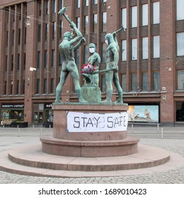 Helsinki, Finland - March 31, 2020: The Three Smiths statue in central of Helsinki has got a coronavirus-inspired makeov