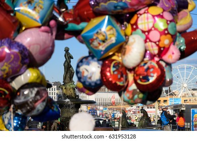 HELSINKI, FINLAND - MAY 1, 2017: Statue of Havis Amanda located at Kauppatori in downtown Helsinki seen through colourful balloons during First of May (Vappu) celebration.
