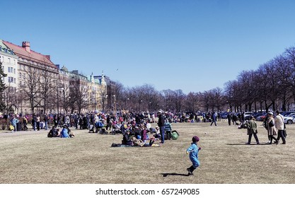 HELSINKI, FINLAND - MAY 1, 2017. May Day Labor Day Vappu celebration. People sitting on the Kaivopuisto