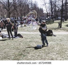 HELSINKI, FINLAND - MAY 1, 2017. May Day Labor Day Vappu celebration. A student blowing bubbles