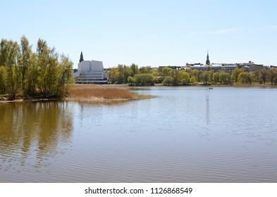HELSINKI, FINLAND - May 13, 2018: Toolo bay in the City Park in Helsinki, Finlandia Hall congress and event venue can be seen across the water