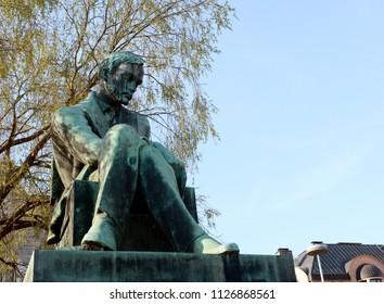 HELSINKI, FINLAND - May 13, 2018: Statue of Aleksis Kivi in Rautatientori Square, Helsinki. The statue was sculpted by Waino Aaltonen in 1939.