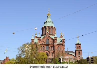 HELSINKI, FINLAND - May 14, 2018: Uspenski Cathedral, an Eastern Orthodox cathedral in Helsinki, overlooking the city from the Katajanokka peninsula