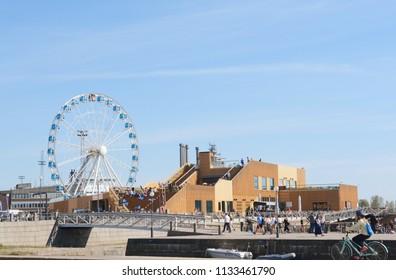HELSINKI, FINLAND - May 14, 2018: Finnair Skywheel, a 40 metre observation wheel, and Allas Sea Pool in downtown Helsinki