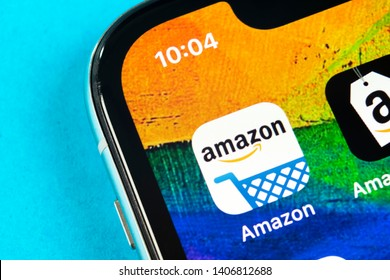 Helsinki, Finland, May 4, 2019: Amazon shopping application icon on Apple iPhone X screen close-up. Amazon shopping app icon. Amazon mobile application. Social media network