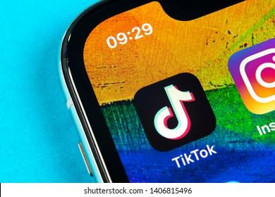 Helsinki, Finland,  May 4, 2019: Tik Tok application icon on Apple iPhone X screen close-up. Tik Tok icon. tik tok application. Tiktok Social media network. Social media icon