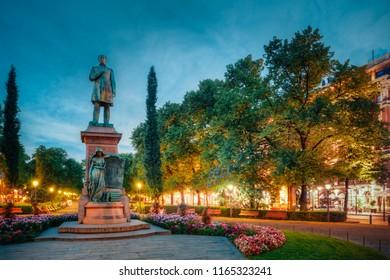 Helsinki, Finland. Night View Of Esplanade Park. Statue Of Johan Ludvig Runeberg in Helsinki, Finland
