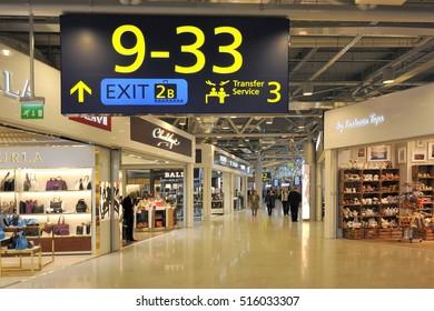 HELSINKI, FINLAND - NOVEMBER 16: Travelers and shops at Helsinki International Airport. November 16, 2015 Helsinki, Finland