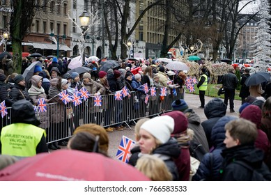 HELSINKI, FINLAND - NOVEMBER 30, 2017: Official visit of Duke of Cambridge in Finland. Helsinki crowd with british flags waiting to greet Prince William at Esplanade Park.