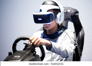 HELSINKI, FINLAND - NOVEMBER 4, 2016: VR games. Teens use virtual reality helmets Sony PlayStation 4, racing simulator.
