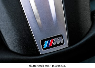 Helsinki, Finland, November 4, 2019: Close up view of a BMW M Logo on black leather steering wheel sports car. M Performance Edition. Car exterior details.