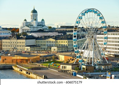 HELSINKI, FINLAND - OCT 2, 2016: View of Market square, Finnair Sky Wheel (Observation Wheel) and Lutheran Helsinki Cathedral (Tuomiokirkko). Golden autumn