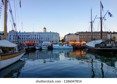 Helsinki, Finland - October 7, 2015: Fishing boats and an old sailing boat at the Helsinki Market Square during the annual Helsinki Baltic Herring Fair (Silakkamarkkinat in Finnish).