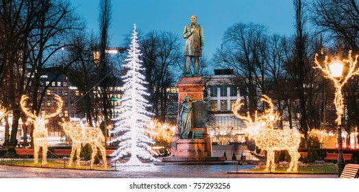 Helsinki, Finland. Panorama Of Statue Of Johan Ludvig Runeberg On Esplanadi Park In Lighting At Evening Or Night Illumination. Famous Landmark. Monument To National Poet And Lyric Of Finland.
