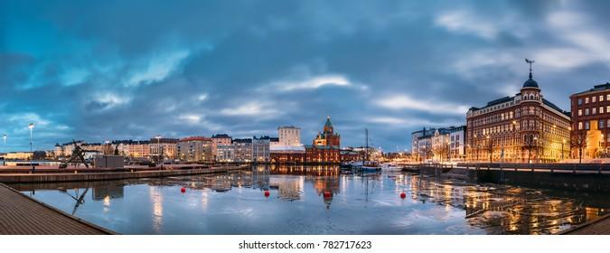 Helsinki, Finland. Panoramic View Of Pier, Embankment On Kanavaranta Street, Uspenski Cathedral And Pohjoisranta Street In Evening Illuminations.