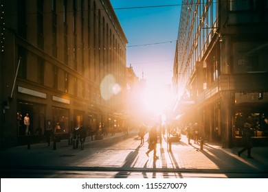 Helsinki, Finland. People Walking On Kluuvikatu Street In Winter Sunlight. Street Decorated For Christmas And New Year Holiday. Sunrise Morning Time