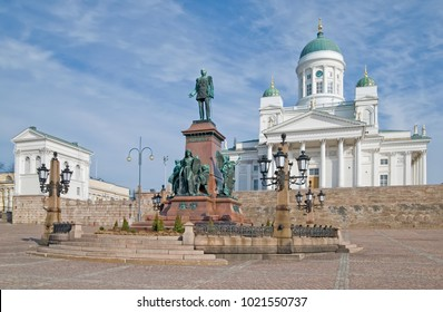 Helsinki. Finland. Senate Square. Helsinki Cathedral also known as a St Nicholas Church and Alexander II Sculpture in the foreground