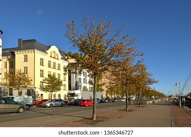 HELSINKI, FINLAND - SEPT 27, 2018:  embankment, road and harbor with old yacht and ships. Helsinki, Suomi