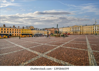 Helsinki, Finland - September 10 2018: Tour buses line up near the monument statue of Czar Alexander II at the Senate Square in Helsinki Finland