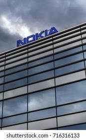 HELSINKI, FINLAND - SEPTEMBER 16, 2017: Dark clouds over Nokia brand name on top of a building in Helsinki, Finland on September 16, 2017