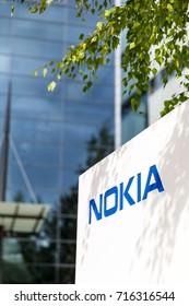HELSINKI, FINLAND - SEPTEMBER 16, 2017: Blue Nokia brand name on a white board in Nokia headquarter in Helsinki, Finland on September 16, 2017