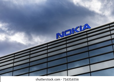 HELSINKI, FINLAND - SEPTEMBER 16, 2017: Dark clouds over Nokia brand name on top of a building in Helsinki, Finland on September 16, 2017