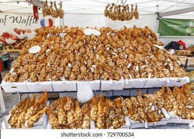 HELSINKI, FINLAND - SEPTEMBER 16, 2017: Table full of onion bouquets in a market in Helsinki, Finland on September 16, 2017