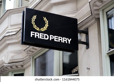 Helsinki, Finland - September 19 2017:  Fred Perry store shop sign. Fred Perry British clothing label brand logo logotype. Editorial use only.