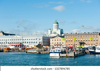HELSINKI, FINLAND - SEPTEMBER 19, 2018: Market Square and Helsinki Cathedral in sunny autumn day