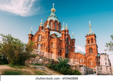 Helsinki, Finland. Uspenski Orthodox Cathedral Upon Hillside On Katajanokka Peninsula Overlooking City. Church Of Red Brick In Summer Sunny Day, Popular Tourist Sightseeing