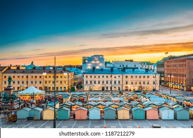 Helsinki, Finland. View Of Christmas Xmas Market On Senate Square In Sunset Sunrise Evening Illuminations.