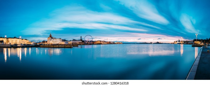 Helsinki, Finland. View Of Embankment With Ferris Wheel And Uspenski Cathedral In Illuminations During Morning Sunrise Time. Panoramic View, Panorama.