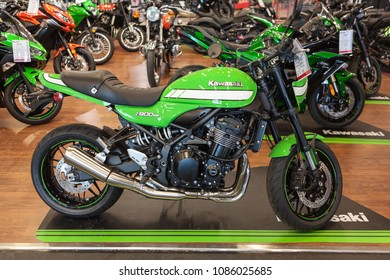 HELSINKI, FINLAND-CIRCA APR, 2018: Modern motorcycle Kawasaki Z900RS Cafe is in showroom of Biketeam Vantaa shop. Sale of new, used motorcycles and scooters