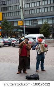 HELSINKI, FINLAND-SEPTEMBER 27: Street musicians play on the street in the city of Helsinki, Finland SEPTEMBER 27 2013.n Finland there are a lot of musicians on streets of the cities.