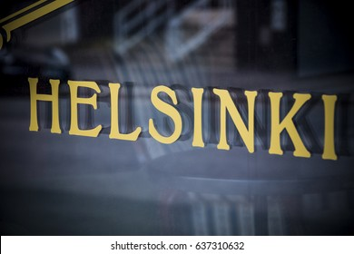 Helsinki golden sign in window in the Finnish capital