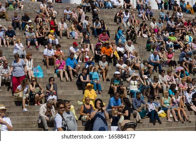 HELSINKI - JUNE 08: Spectators and guests sit on the stairs Helsinki Cathedral. Latin dance festival, June 8, 2013 in Helsinki, Finland