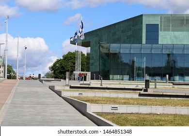 Helsinki Music Centre (Musiikkitalo) and a beautiful yet simple park next to it during a sunny summer day in Helsinki, Finland, July 2019. Urban Scandinavian landscape photo of the downtown.
