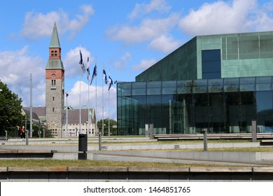 Helsinki Music Centre (Musiikkitalo) and the National Museum of Finland (Kansallismuseo) during a sunny summer day in Helsinki, Finland, July 2019. Urban Scandinavian landscape photo of the downtown.