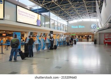 HELSINKI - SEP 03: self check-in kiosks on September 03, 2014 in Helsinki, Finland. Helsinki Airport  is the main international airport of the Helsinki metropolitan region and the whole of Finland