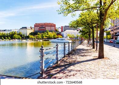 HELSINKI : Sunny summer day near canal in Siltasaari (a central neighborhood of Helsinki)