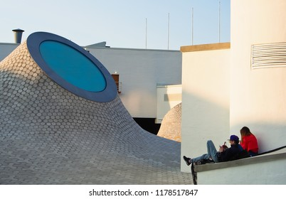 helsinki, uusimaa/finland - 8/29/2018: travlers resting on ground level of new underground Amos Anderson Art Museum (Amos Rex) in Lasipalatsi square of downtown