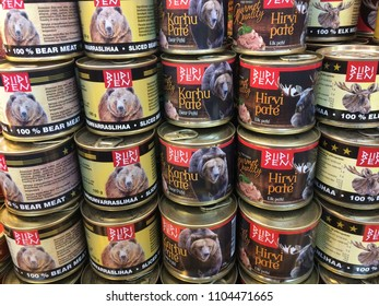 HELSINKI/FINLAND – 24 MAY, 2018:  Meat of bear, canned goods. Central market in Helsinki, Sellers, buyers. People, trade, products