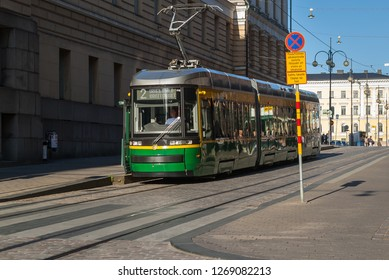 Helsinki/Finland-August 5, 2018 Green Artic tram in the central part of the city. ARTIC or For City Smart, is an articulated low-floor tram model designed and manufactured by Transtech.